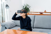 Woman Looking Away In VR Glasses