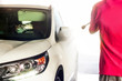 Car wash, black car in automatic car wash, rotating red and blue brush. Washing vehicle.