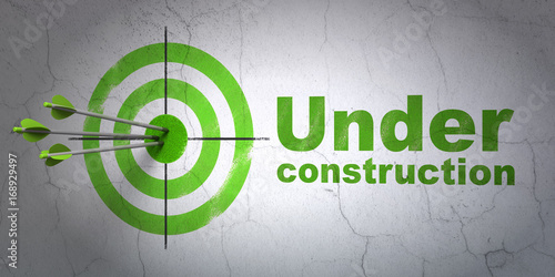 Photo  Web design concept: target and Under Construction on wall background