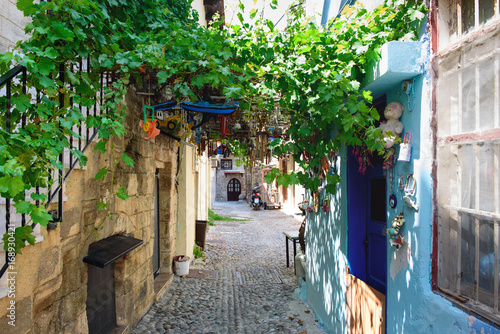Narrow street on Rhodes island with traditional Greek houses