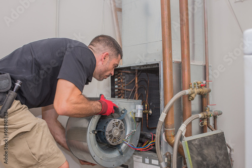 Fotografia  Hvac technician with Motor