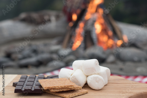 Fotografie, Obraz  Smores Ingredients at a Beach Bonfire with Chocolate, Marshmellow, and Graham Cr