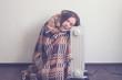Leinwandbild Motiv young woman in woolen plaid warm up hands over electric heater