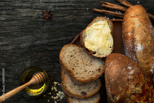 Foto auf Leinwand Brot Freshly baked traditional Italian Cibatta bread cut in slices on a wooden table