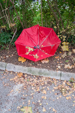 Broken Red Umbrella On The Sid...