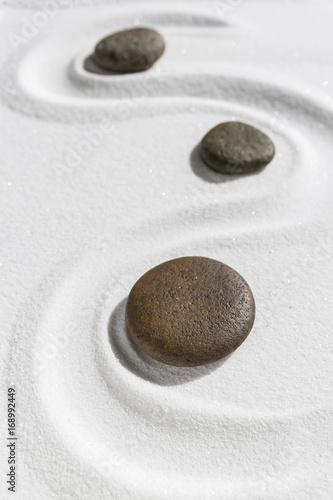 Deurstickers Stenen in het Zand Zen stone on white sand background