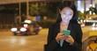 Business woman using mobile phone at Hong Kong city