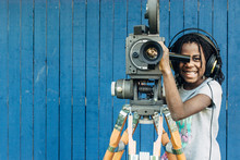 Smiling Black Girl With Motion Film Camera