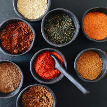 Assorted Colorful Spices In Bo...