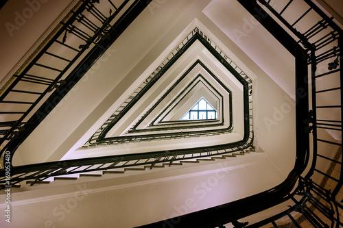 Photo Stands Stairs Old triangular spiral stairway case from below