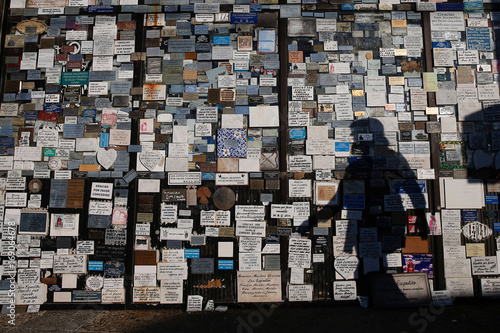 The shadow of a woman is seen next to thank-you cards