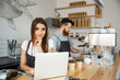 Coffee Business Concept - beautiful caucasian bartender barista or manager working and planing in laptop at modern coffee shop.