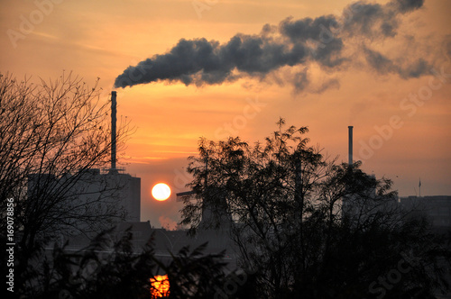 Fotografie, Obraz  Horizon industry in a small netherland town in Europe, with a big chimney and sm