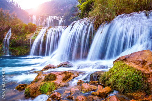 Photo Stands Waterfalls Jiulong waterfall in Luoping, China.