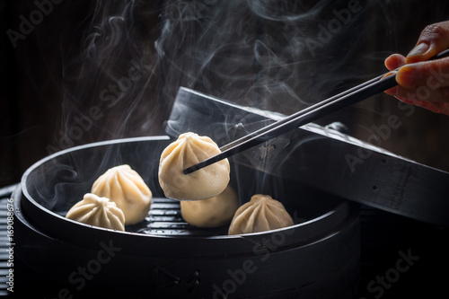 Yummy and hot chinese dumplings on black background