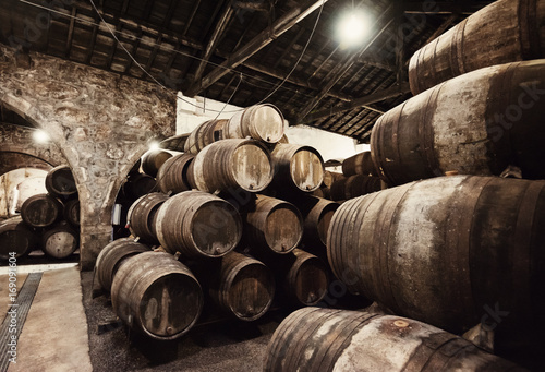 Old wooden barrels in wine cellar
