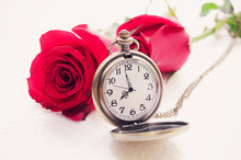 Red Rose And A Pocket Watch On...