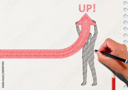Photo 矢印を上に向けるビジネスマンのシルエットとノートの背景