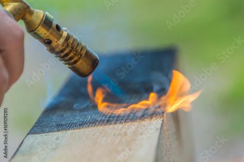 fire treated hardwood timber. Wallpaper Mural
