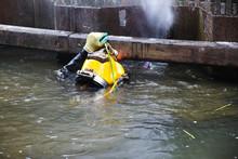 Diver With Yellow Helmet Worki...