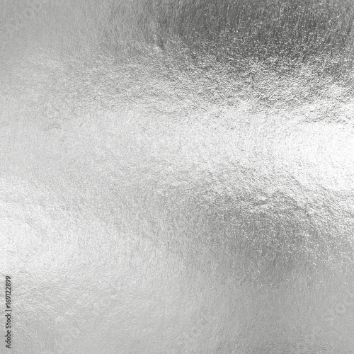 Fotografía  Silver foil shiny metallic texture background wrapping paper for wallpaper decor