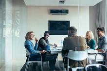 Female Manager Leads Brainstorming Meeting In Office