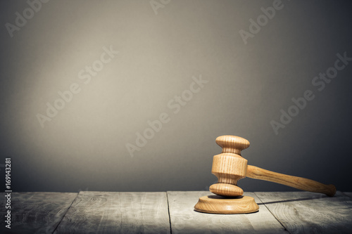 Auction or judge wooden gavel on table Wallpaper Mural