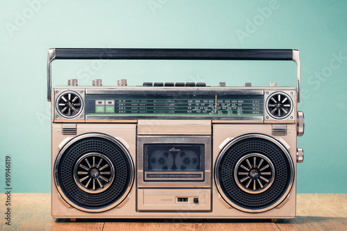 Fotografía Retro outdated cassette tape recorder from 80s on table front mint green background