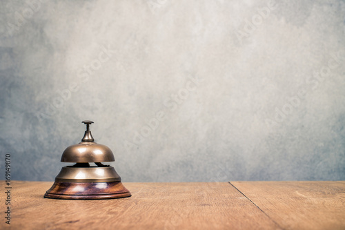 Vintage Hotel Reception Service Desk Bell Front Textured Concrete Wall Background Old Retro Style Filtered