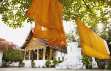 Saffron Robes Hanging In The Courtyard Of Vat Paphaimisaiyanaram. (This Is The Same As Wat Pa Pai.) Luang Prabang, Laos.
