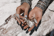 Close Up Of Woman Hands Holding Magic Stones