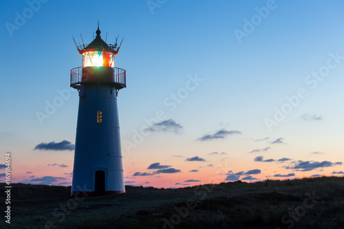 Fototapeten Leuchtturm Lighthouse List West after sunset.