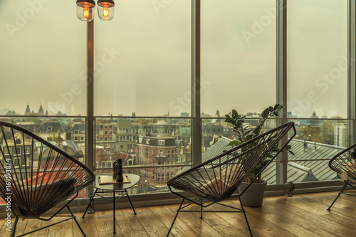 Cafe with view of Amsterdam Wallpaper Mural