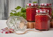 Jars with homemade Caucasian tomato sauce