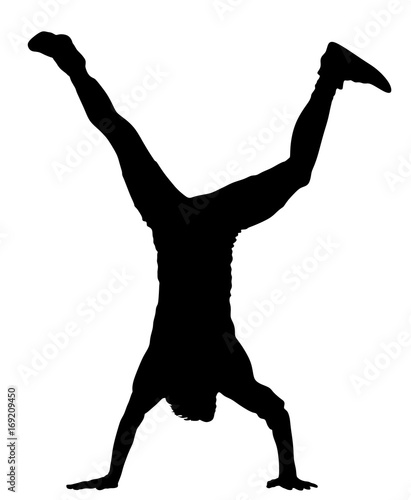 Young man doing cartwheel Canvas Print