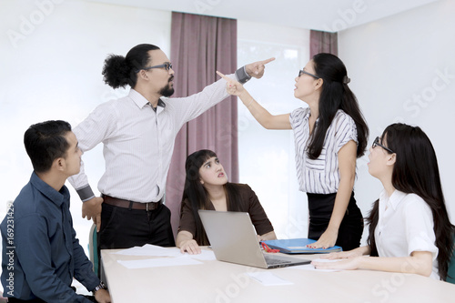 Business people having a conflict in the office Canvas Print