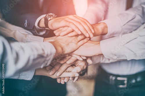 Fotografía  Stack of hands. Unity and teamwork concept.