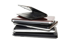 Old Laptops. A Stack Of Old Laptops On A White Background. Five Pieces. Isolated.