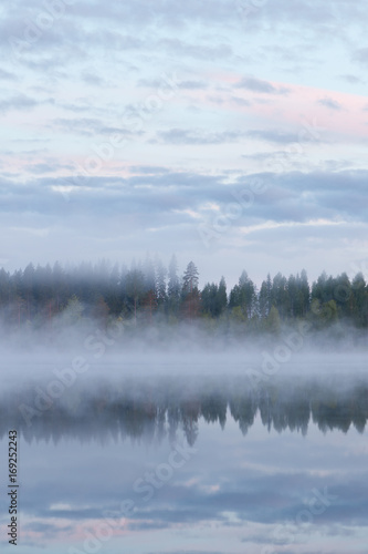 Fotobehang Bergen Calm foggy lake scape summer night