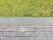 Close up brick walkway and green grass
