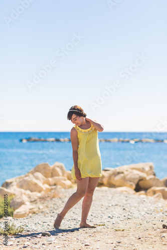 Deurstickers Cyprus happy young woman posing on the beach of sea