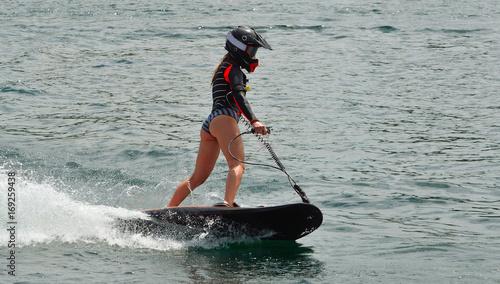 Poster Nautique motorise Female Motosurf Competitor moving at speed.