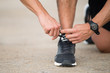 Unrecognizable runner preparing for jogging