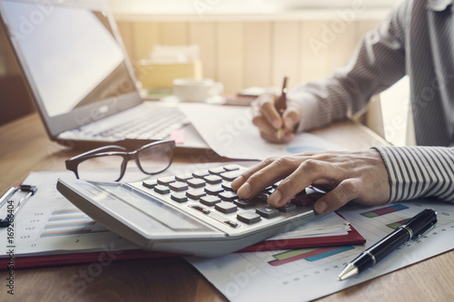 Fototapeta Businessman working on Desk office business financial accounting calculate obraz
