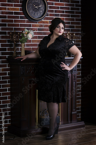 Recess Fitting Plus size model, fat woman in black evening dress