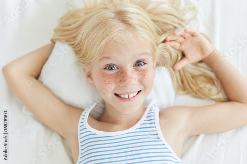 cute little female child with blonde hair blue eyes and freckled