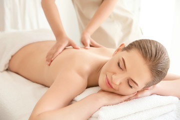 Young beautiful woman having massage in spa salon