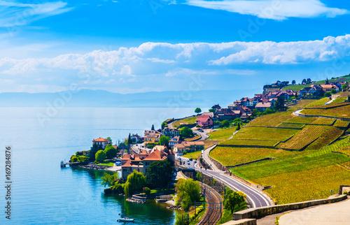 Cuadros en Lienzo Vineyards and village in Lavaux against Geneva lake, Switzerland