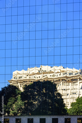 Commercial and business building with modern architecture and glass façade with Poster