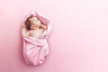 Fototapeta Newborn baby girl sleep on pink blanke
